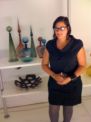 Pictured with glass vessels by Joe Cariatti, Michele Colico is owner of a new ca