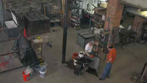 Kevin Kutch (seated) and Kevin Scanlan blowing glass at Pier Glass.