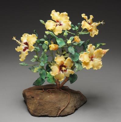 Carolyn Baum, Eternal Bloom, 2013. Flameworked soft glass, wire, fieldstone. H 12, W 12, D 10.