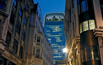 An architectural rendering of 20 Fenchurch street at dusk, with the computer-generated glare of the setting sun. Image appears on the Rafael Viñoly Architects Website.